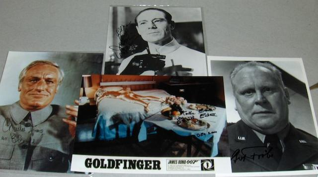 A collection of James Bond villain related autographs, together with one Bond girl autograph,
