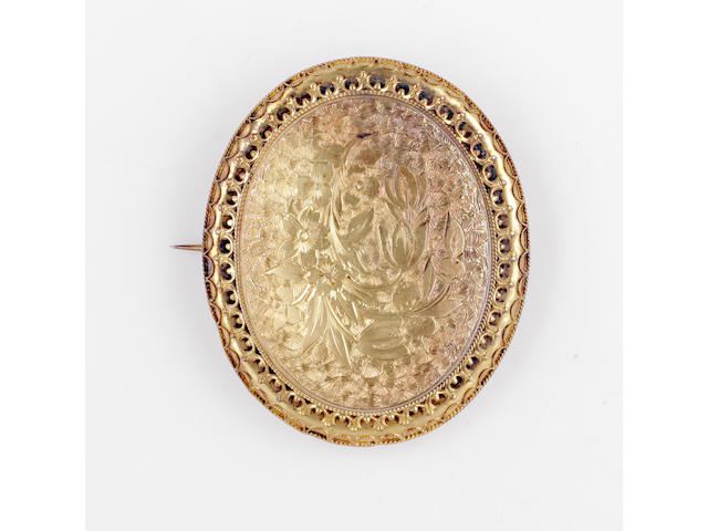 A 19th Century floral engraved panel brooch, (3)