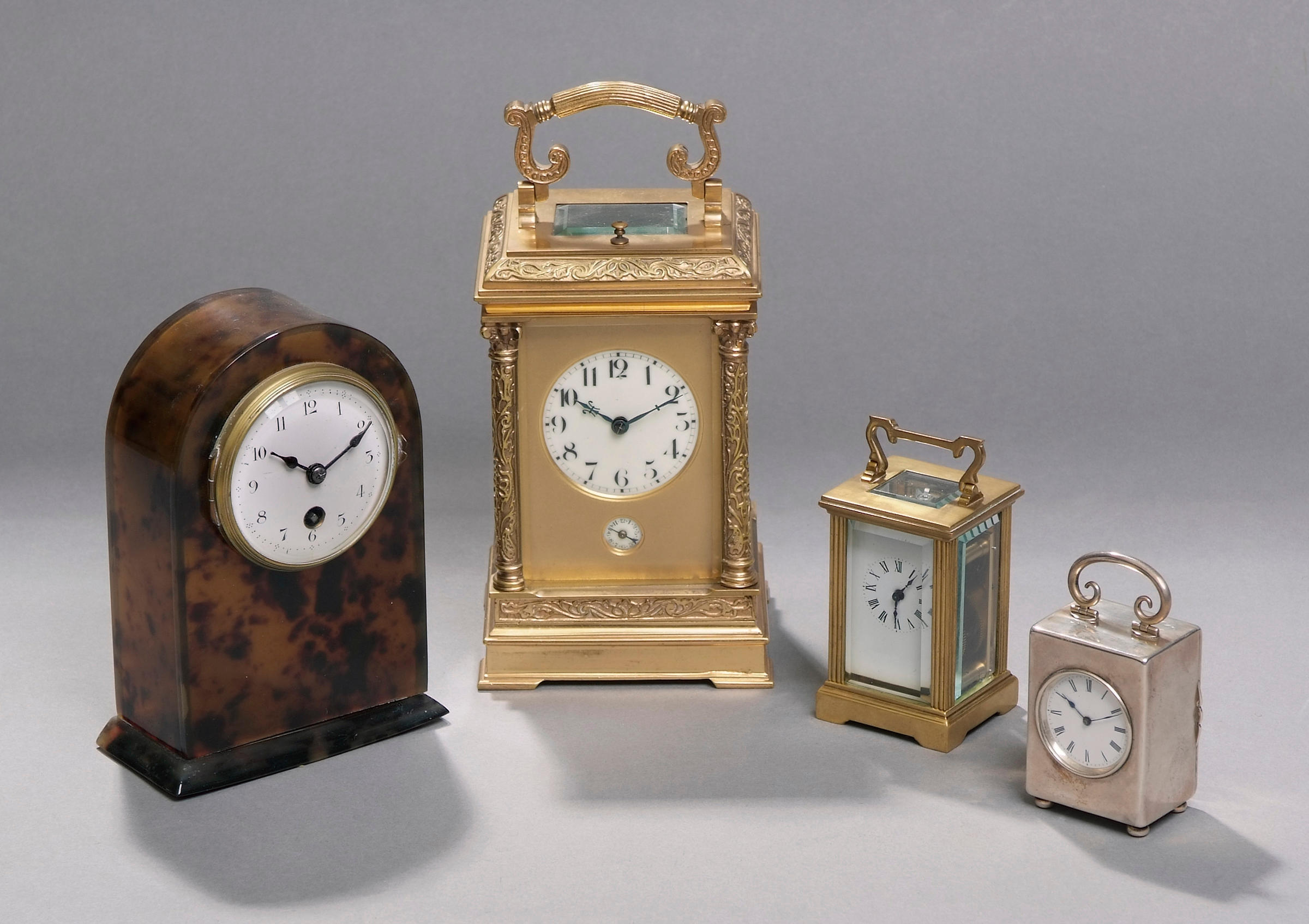 A miniature silver cased carriage timepiece