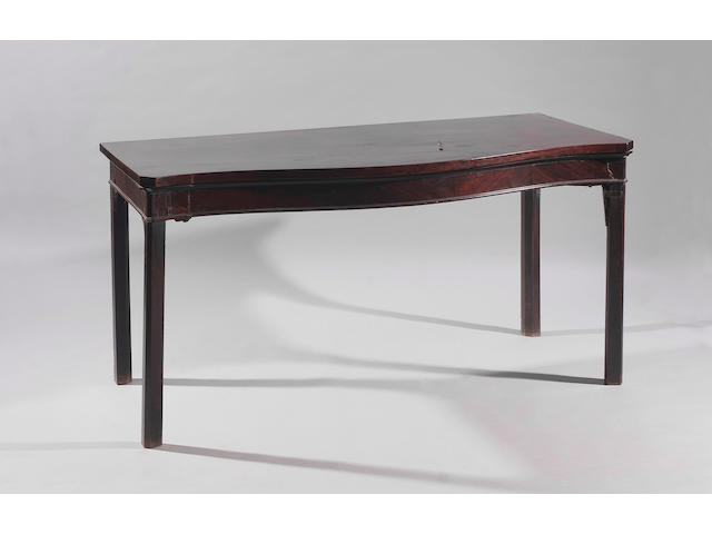 A George III mahogany serpentine front serving table