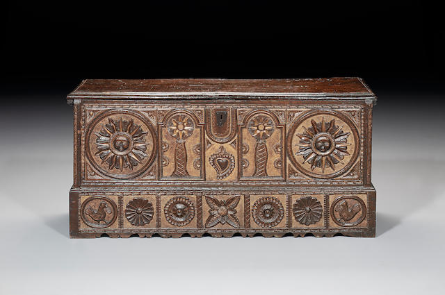 A 17th century Spanish carved walnut and parcel gilt coffer