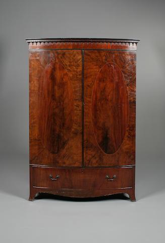A George III style mahogany bowfronted wardrobe