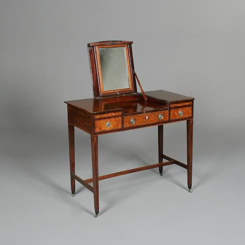 A George III mahogany and satinwood enclosed dressing table