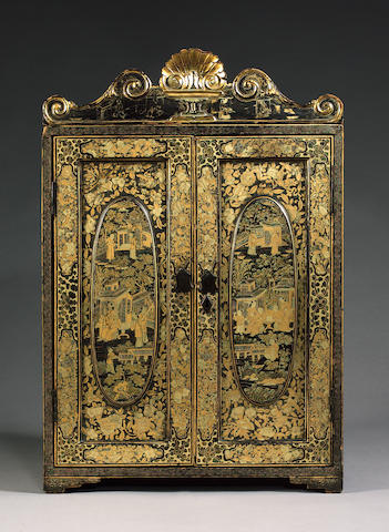 A mid 19th century Chinese export gilt and black lacquered table cabinet