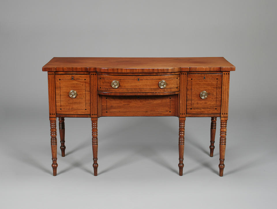 A George IV mahogany and boxwood strung bow breakfront sideboard