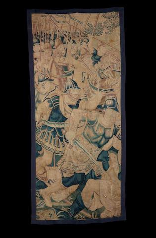 A 17th century Flemish tapestry fragment Belgium, 230cm high, 104cm wide.