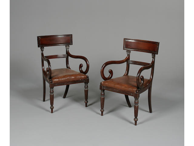 A set of twelve William IV mahogany dining chairs