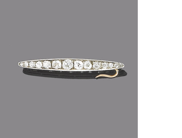 A diamond bar brooch,