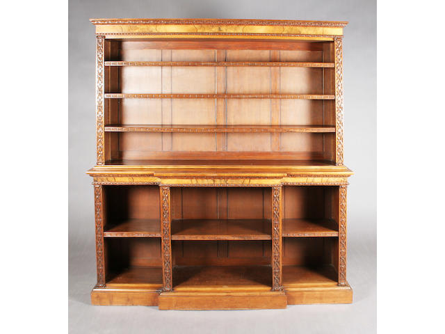 A Victorian figured and foliate carved walnut open bookcase