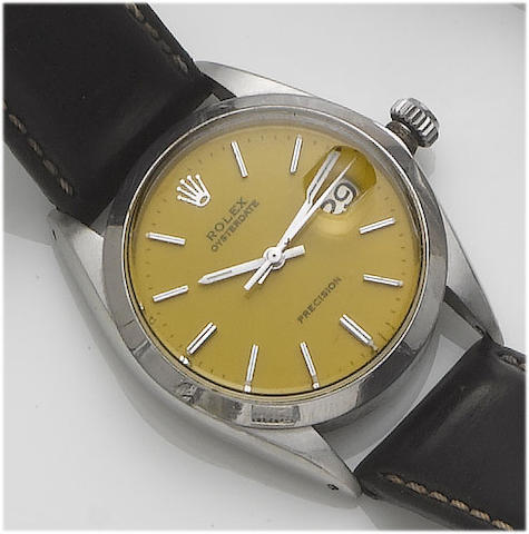 Rolex. A stainless steel centre seconds calendar wristwatch with yellow dialOysterdate, 1966