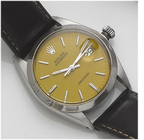 Rolex. A stainless steel centre seconds calendar wristwatch with yellow dial Oysterdate, 1966