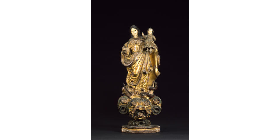 A rare 18th century Goanese / Phillipine giltwood, polychrome decoration and ivory figure of the Madonna and Child