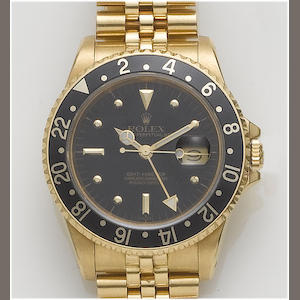 Rolex. An 18ct gold automatic calendar bracelet watch GMT-Master, 1980's