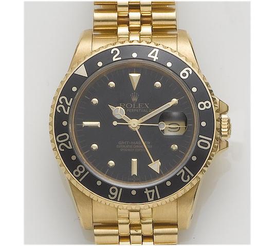 Rolex. An 18ct gold automatic calendar bracelet watchGMT-Master, 1980's