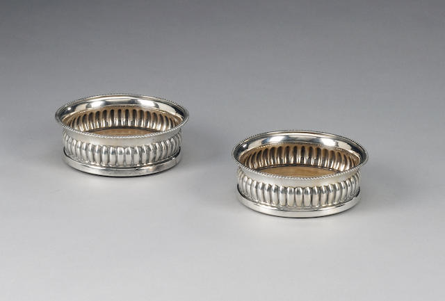 A pair of George III silver circular coasters, by John Roberts & Co, Sheffield 1806,