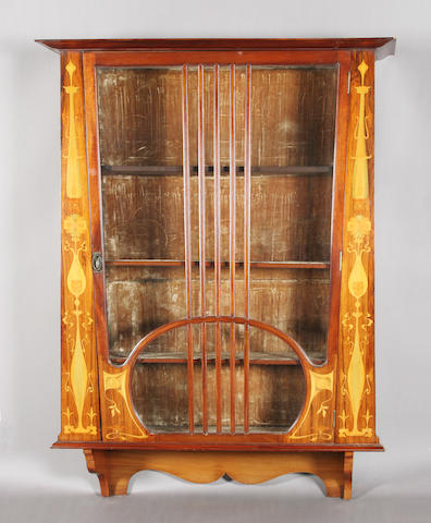 An Art Nouveau period rosewood, mahogany and marquetry inlaid wall display cabinet