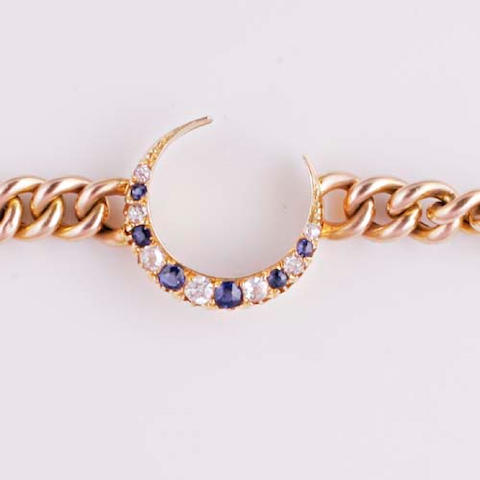 A curb-link sapphire and diamond crescent bracelet