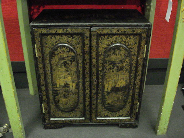 A late 19th century Chinese export black lacquered table cabinet