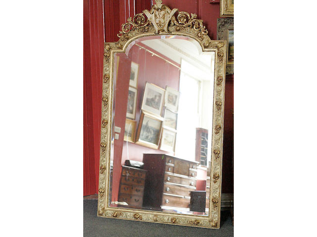 A gilt framed arched top mirror