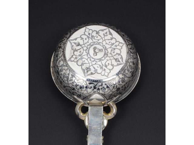 A 19th century Southern Russian silver and niello work ladle, maker's mark Arabic script initials, unidentified, Tbilissi, 1869,