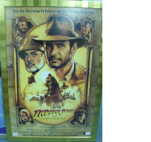 Two signed reproduction film posters, E.T and Indiana Jones and the Last Crusade, together with signed Buffy montage,3