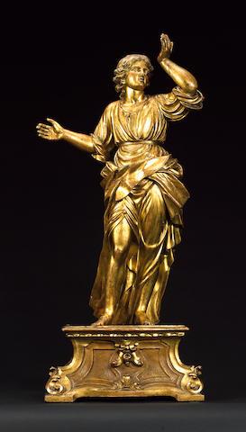 An 18th century South German/North Italian gilt carved figure of a female Saint