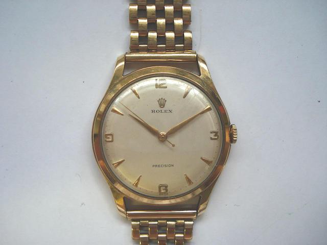 Rolex. A 9ct gold centre seconds bracelet watch Birmingham Hallmark for 1959