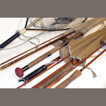 Five fishing rods,a rod support and a landing net. (7)