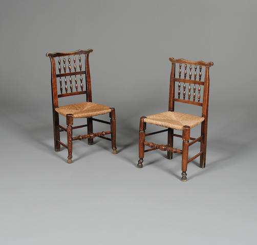 A matched set of eight late 19th Century fruitwood spindle back chairs