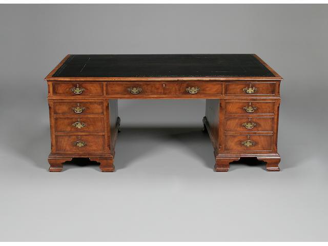 A  Victorian walnut pedestal partners desk