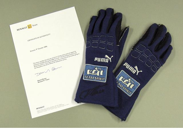 A pair of gloves signed by and worn by Fernando Alonso during the 2006 British Grand Prix,
