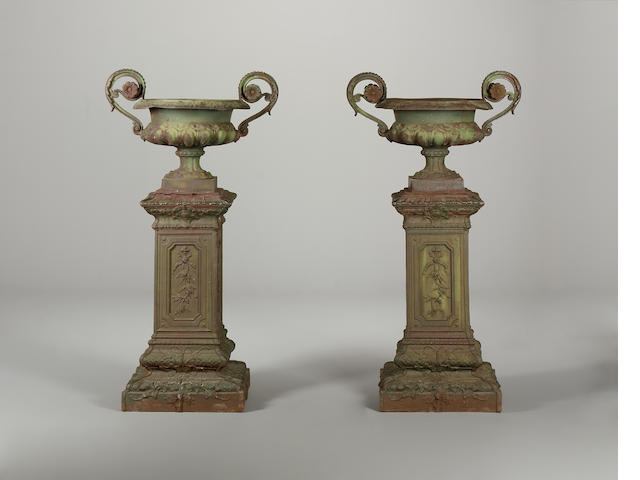 A pair of French late 19th century cast iron urns