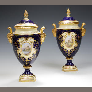 A pair of Coalport urn shaped vases and  covers early 20th century