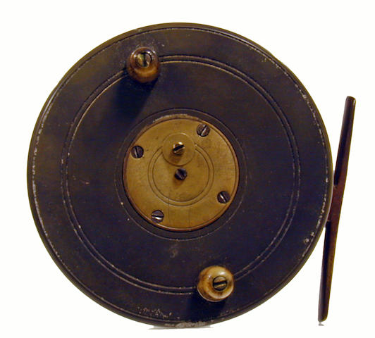 An ebonite and brass star back centre pin reel 4in