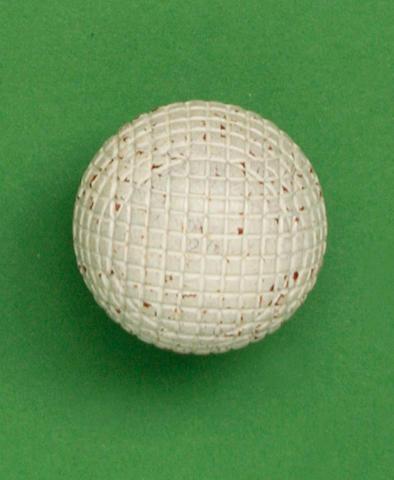 A Silvertown A1 27 ½  (Red) gutty golf ball circa 1891