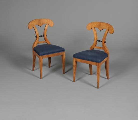 A set of six Austrian Biedermeier birch dining chairs