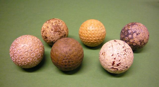 A collection of golf balls with interesting cover patterns