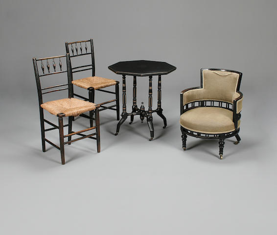 A pair of late 19th century ebonised Morris and Co. Sussex side chairs