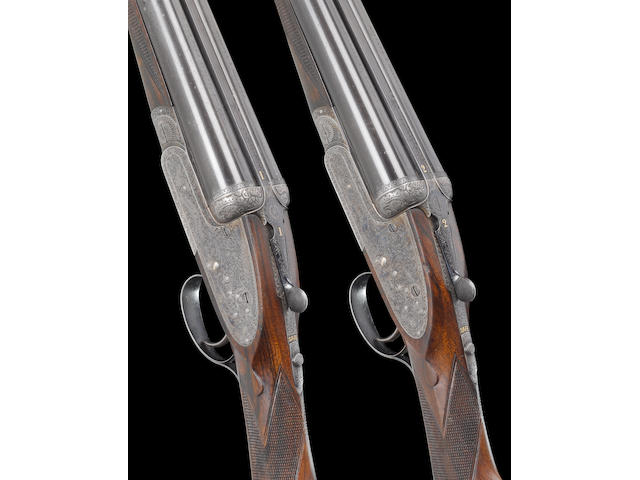 A fine pair of 12-bore 'Royal' single-trigger sidelock ejector guns by Holland and Holland, no. 22873/4 In their brass-mounted oak and leather case