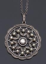 An Edwardian diamond and pearl circular pendant