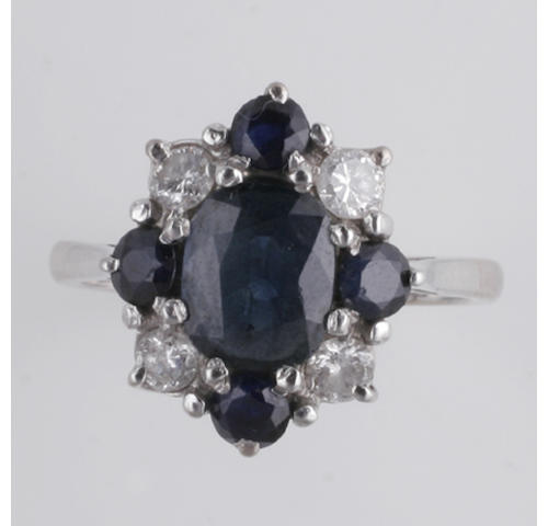 An 18ct white gold sapphire and diamond cluster ring,