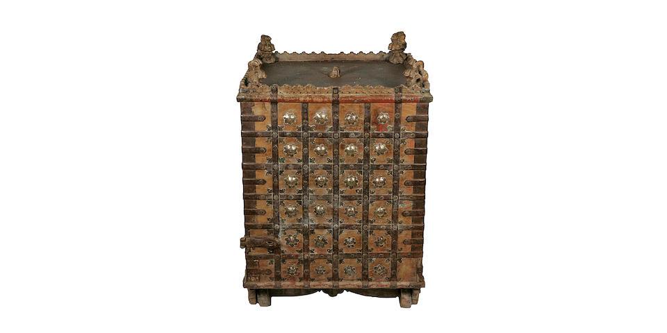 A Jain [Sanskrit: Jaina] temple, offering chest on wooden wheels;