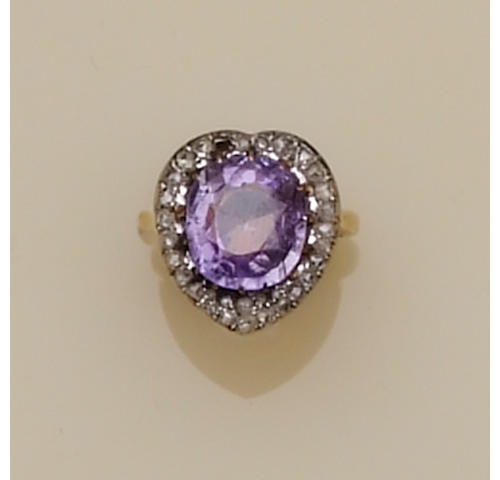 A purple sapphire and diamond cluster ring