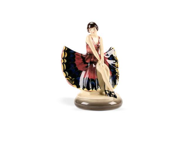Joseph Lorenzl for Goldscheider, a figure of a butterfly girl