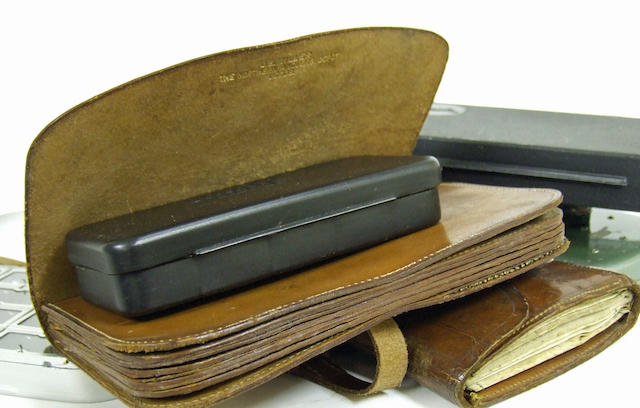 A J. E. Miller,  The Northern Anglers Depot, Leeds, six compartment strapped leather wallet for baits or casts