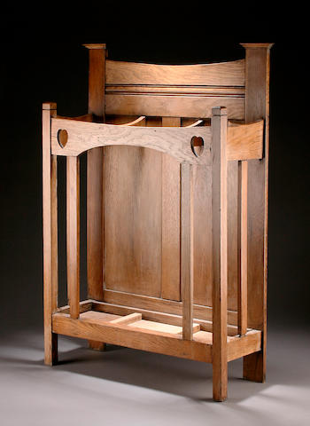A well proportioned light oak umbrella stand