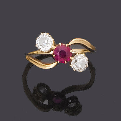 An early 20th century ruby and diamond three-stone ring