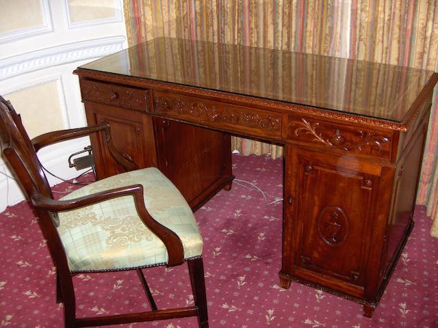 An early 20th century mahogany pedestal desk