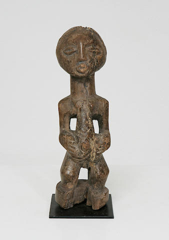 A wood female figure,