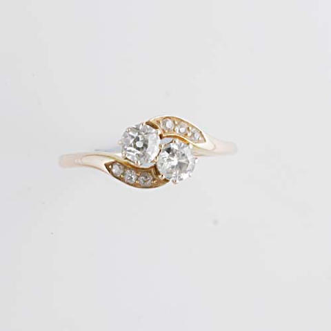 A two stone diamond crossover ring,